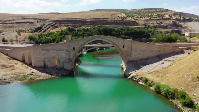 The Malabadi Bridge. The Malabadi Bridge is an arch bridge spanning the Batman River near the town of Silvan in southeastern Turkey. Construction began in the year AH 541 during the Artuqid period, and appears to have been completed in AH 549. mardin stock videos & royalty-free footage
