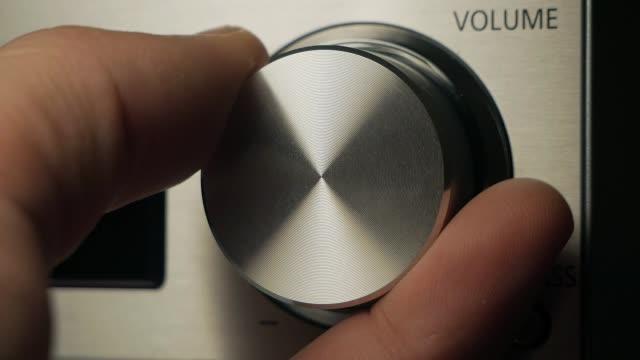The man adjusts the volume video