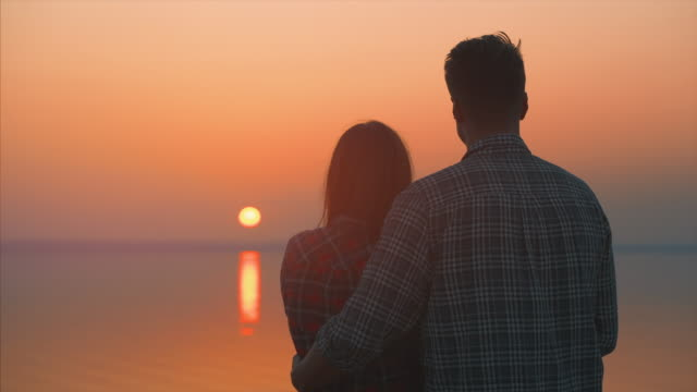 The man and woman against the beautiful sunset The man and woman against the beautiful sunset boyfriend stock videos & royalty-free footage