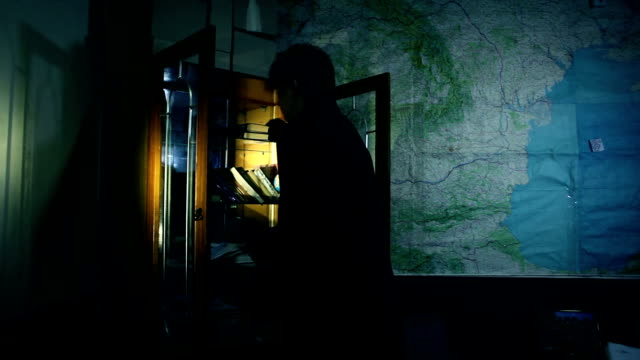The man at filing cabinet. Detective video