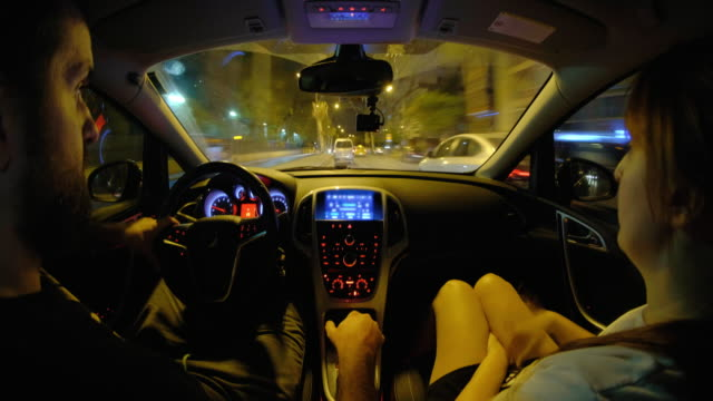 The man driving a car with woman pessenger