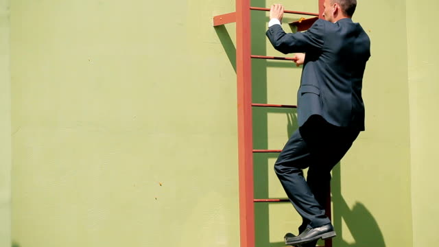 The man in suit climb up the stairs video