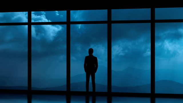 the man standing near panoramic windows on a cloud stream background. time lapse - man look sky scraper video stock e b–roll