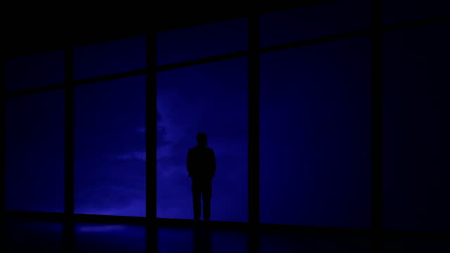 the man standing near window on the night thunderstorm with lightning background - man look sky scraper video stock e b–roll