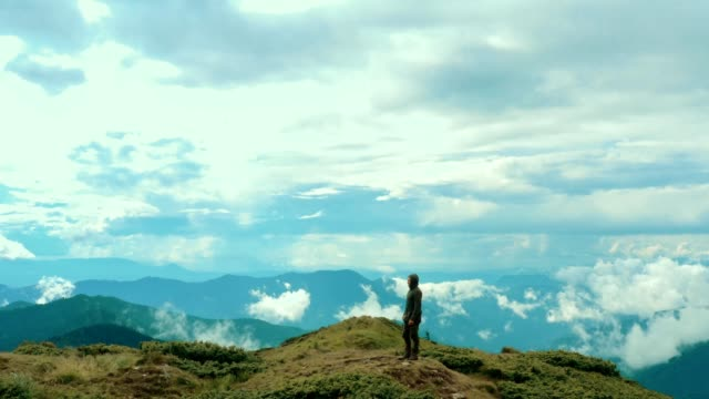 The man standing on the beautiful mountain The man standing on the beautiful mountain horizon over land stock videos & royalty-free footage