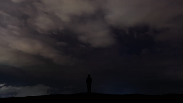 The man standing on the lightning stream background. time lapse