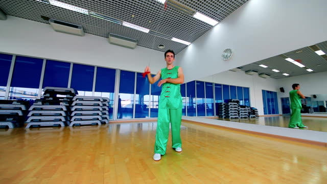 The man training his skills in the moving of the chain in the gym video