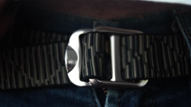 The Man Wears A Belt. Close-Up.