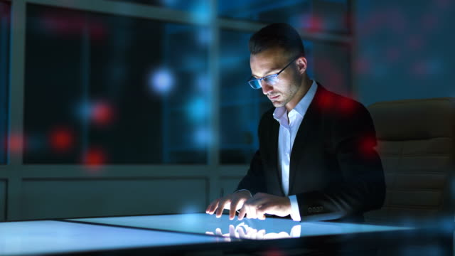 the man working with a sensor display on the hologram background - progettare video stock e b–roll