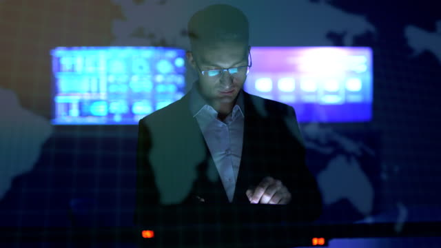 the man working with a tablet on the hologram background - glass world video stock e b–roll