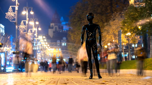 The mannequin standing in a people crowd in the evening street. time lapse