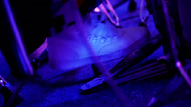 The man's leg presses the bass drum pedal video