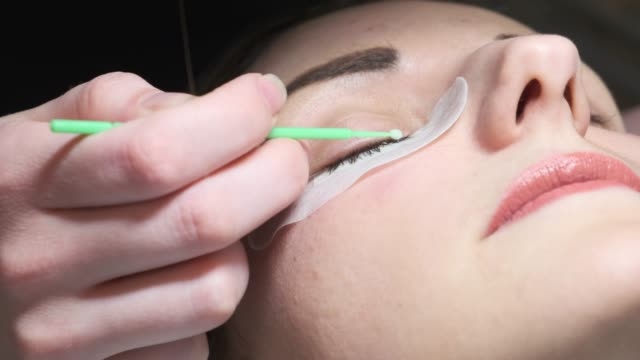 The master adds long fake eyelashes to the client. Eyelash Extension Procedure The master adds long fake eyelashes to the client. Eyelash Extension Procedure eyelash stock videos & royalty-free footage