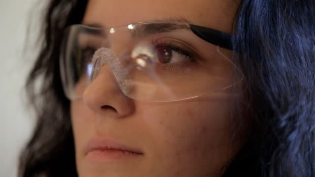 The master on manufacturing jewelry in goggles is working with blanks video