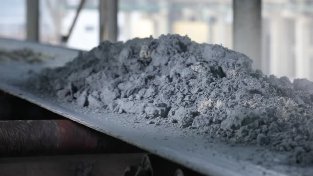 The material on the conveyor belt of the factory production line The material on the conveyor belt of the factory production line cement stock videos & royalty-free footage