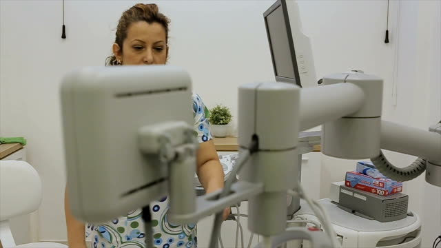 the medical technician works on a modern medical device for early detection of breast cancer video
