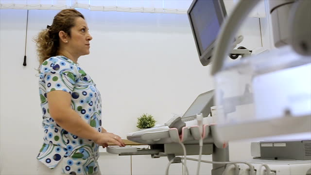 the medical technician works on the most advanced ultrasound device video