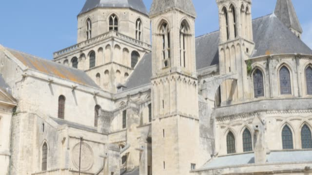 The Mens Abbey by the day William the Conqueror legacy against blue sky 4K The Mens Abbey by the day William the Conqueror legacy against blue sky 4K 3840X2160 slow tilt UltraHD footage - Abbaye aux Hommes located in city of Caen of France in Normandy 4K 2160p UHD video caen stock videos & royalty-free footage