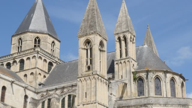 The Mens Abbey William the Conquerer church by the day in front of blue sky 4K The Mens Abbey William the Conquerer church by the day in front of blue sky 4K 3840X2160 slow tilt UltraHD footage - Abbaye aux Hommes located in city of Caen of France in Normandy 4K 2160p UHD video caen stock videos & royalty-free footage