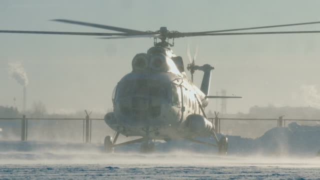 The Mi-8 helicopter is landing The Mi-8 helicopter is landing, the blades are spinning. snowy weather. medevac stock videos & royalty-free footage