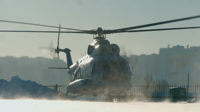 The Mi-8 helicopter takes off The Mi-8 helicopter takes off, the blades spin. snowy weather. medevac stock videos & royalty-free footage