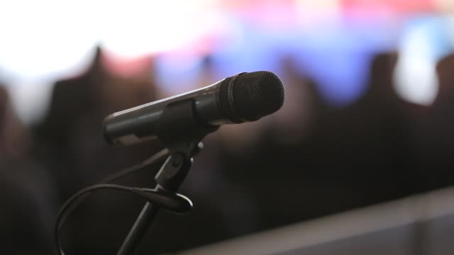 the microphone is on the stage of the conference - politician stock videos and b-roll footage