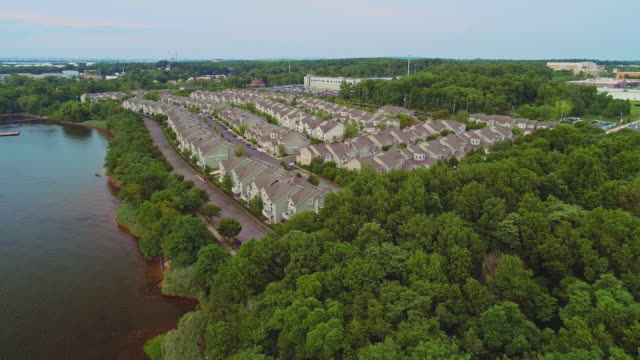 The middle-class suburb houses in Charleston, Staten Island, New York. Panoramic aerial view. Drone video with the descending camera motion.