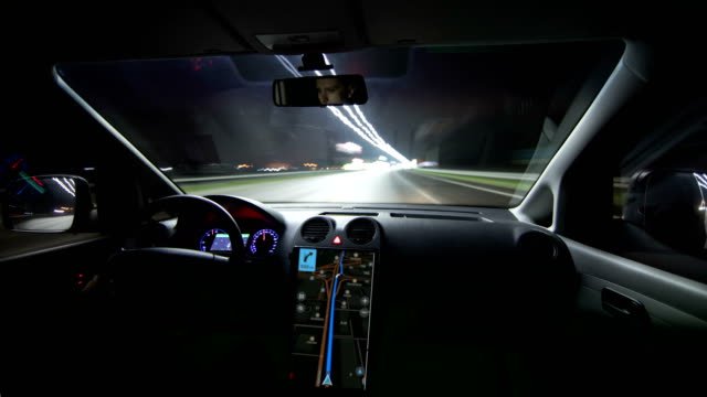 The modern car rides through the night city. Hyperlapse The modern car rides through the night city. Hyperlapse dashboard vehicle part stock videos & royalty-free footage