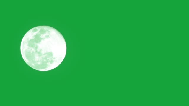 the moon on green background. - księżyc filmów i materiałów b-roll