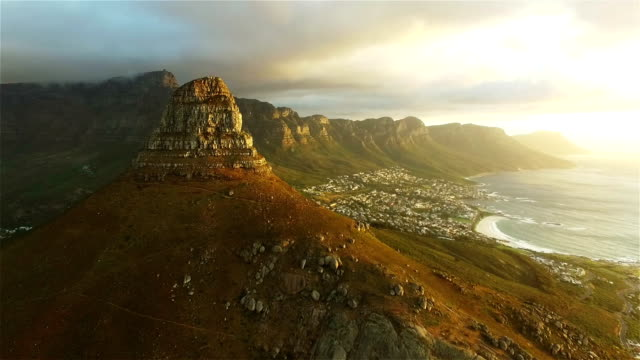 The mountain looks even greater on the other side Aerial drone footage of Lion's Head and Camps Bay in Cape Town, South Africa western cape province stock videos & royalty-free footage