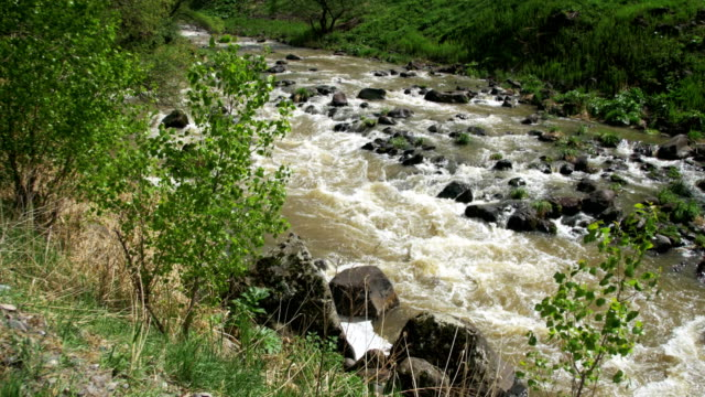 The Mountain River Boils and Quickly Moves Down the Mountain Slope in Georgia video