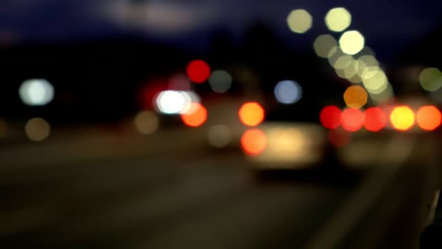 The movement of vehicles on the road, not in focus video