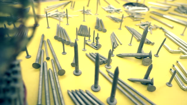 the nails of different shapes and sizes for any purpose, on the shop window - nail work tool stock videos & royalty-free footage