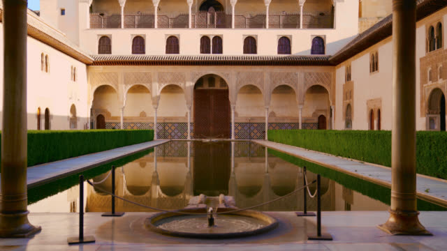 The Nasrid Palaces Courtyard of the Myrtles in the Alhambra fortress in Granada, Spain
