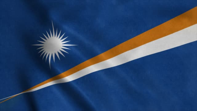 the national flag of marshall islands is flying in the wind. 4k - majuro video stock e b–roll