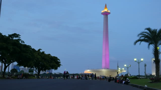 The National Monument, Monas Tower, Jakarta, Indonesia View of the National Monument, Monas Tower in Jakarta, Indonesia. It symbolizes the Indonesian Independence from the colonial domination. People walk and relax around the area. jakarta stock videos & royalty-free footage