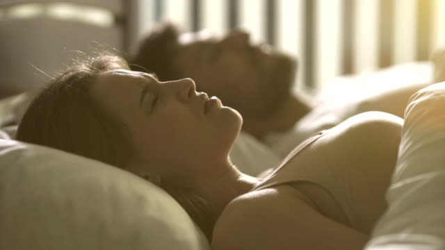 Video The nervous woman lay near the man on the bed