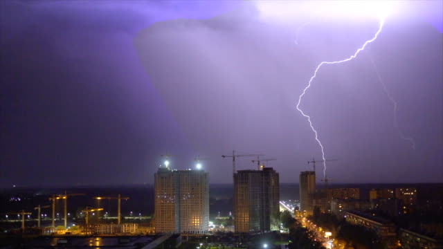 the night city on the bright lightning background - fulmine video stock e b–roll