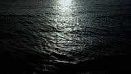 istock The night sea reflects the bright moonlight 1213242996