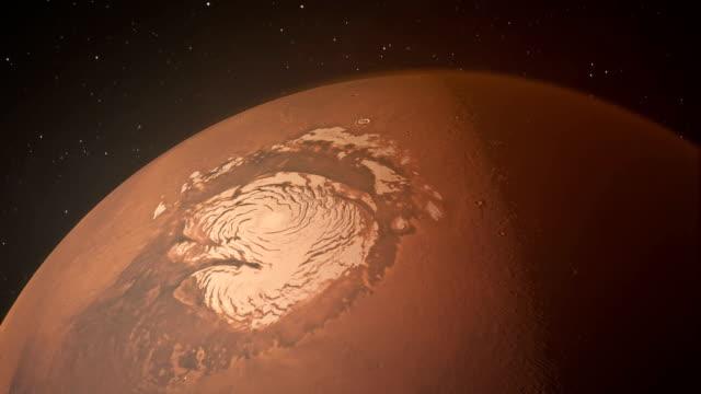 the north polar ice cap on planet mars - asta oggetto creato dall'uomo video stock e b–roll