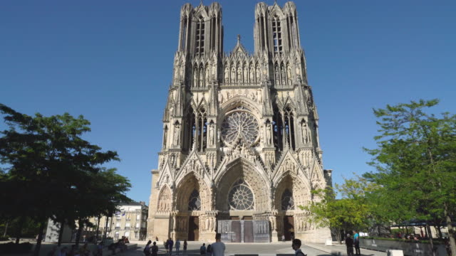 The Notre Dame de Reims Cathedral in Reims, France The Notre Dame de Reims Cathedral in Reims vistied by locals and tourists on a sunny day, France cathedrals stock videos & royalty-free footage