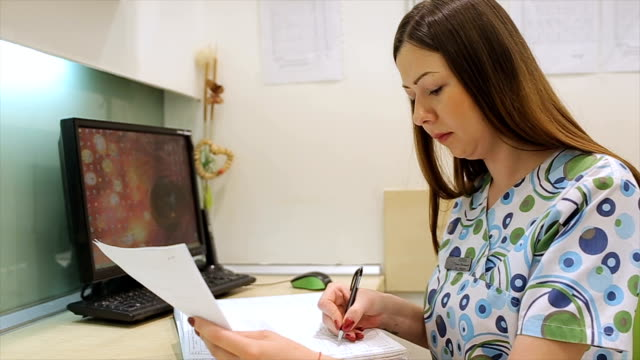 The nurse registers patient data into a medical protocol video