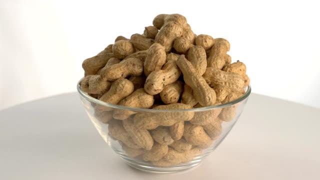 The nut peanut rotates on the turntable. video