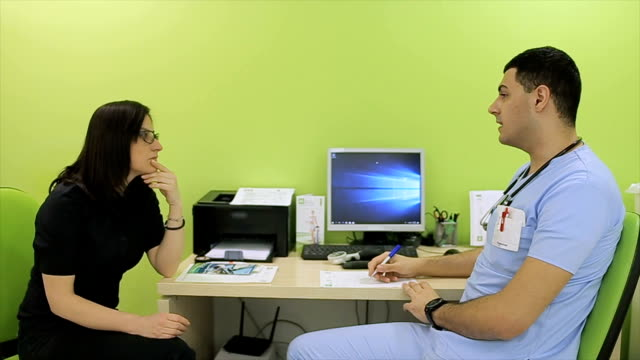 The nutritionist gives nutrition advice to patient The nutritionist gives nutrition advice to patient nutritionist stock videos & royalty-free footage