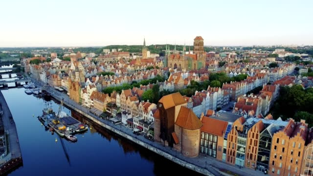 The old town of Gdansk architecture in sunset light. Aerial shot. Channel and buildings - top view the old town of Gdansk architecture in sunset light. Aerial shot. Channel and buildings - top view. Summer time. gdansk stock videos & royalty-free footage