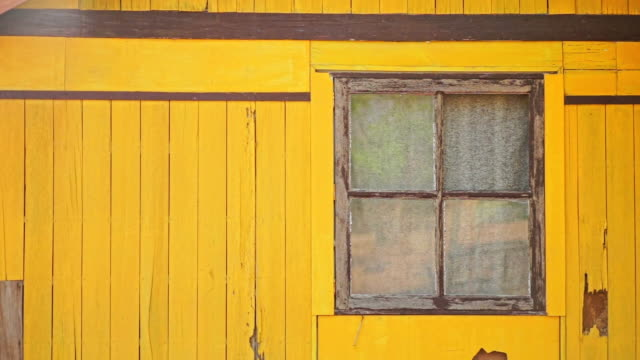 The old yellow wooden house background.