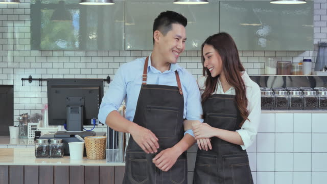 The owner of a couple who has succeeded in doing business in the coffee shop, Coffee shop concept.