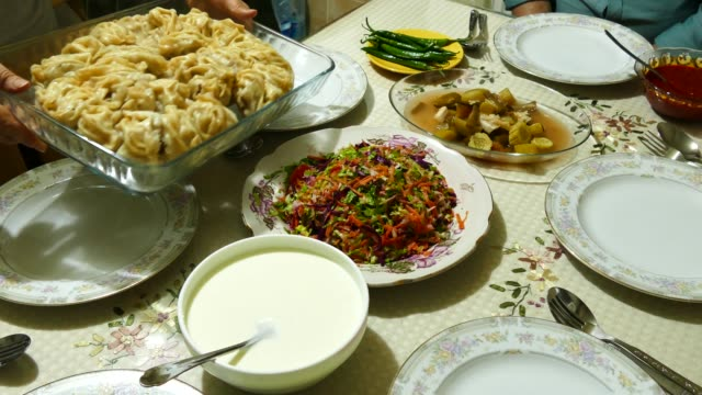 the people who eat ravioli at dinner, serving the Kyrgyz-Uzbek ravioli, ravioli service, the people who eat ravioli at dinner, serving the Kyrgyz-Uzbek ravioli, ravioli service, kazakhstan stock videos & royalty-free footage