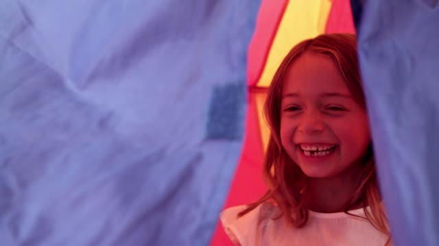 The perfect hideaway from little brothers 4k video footage of a brother and sister playing inside a tent at home fort stock videos & royalty-free footage