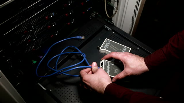 The person works with network cable LAN tester video